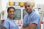 African nurses next to ambulance — Stock Photo