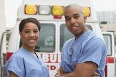 African nurses next to ambulance — Stock Photo
