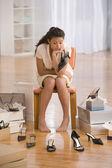 Hispanic girl at shoe store — Stock Photo