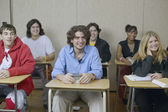 High school students sitting in classroom — Stock Photo