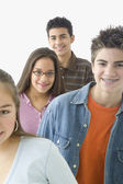 Portrait of four teenagers smiling — Stock Photo