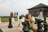 Children playing on life-size chess board — Стоковое фото
