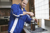 Man making coffee with french press — Stock Photo