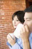 Couple having coffee together — Stock Photo
