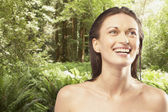 Portrait of woman smiling in forest — Stock Photo
