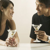 Couple drinking martinis — Stock Photo