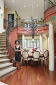 Woman standing by staircase in house — Foto de Stock