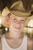 Young boy wearing a cowboy hat — Stock Photo