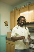 Young man cooking in the kitchen — Stock Photo