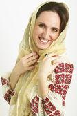 Portrait of woman wearing scarf on head — Stock Photo