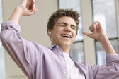 Teenage boy excited listening to music — Stock Photo