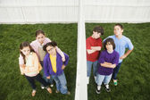 Mixed Race children on opposite sides of fence — Foto Stock