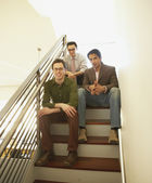 Businessmen sitting on a staircase — Stock Photo