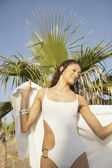 Woman in bathing suit drying off — Stock Photo