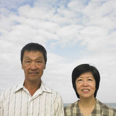 Portrait of couple standing at beach — Stock Photo
