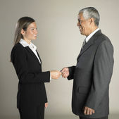 Multi-ethnic businesspeople exchanging business card — Stock Photo