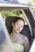 Woman sleeping in passenger seat of SUV — Stock Photo