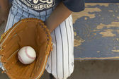 Boy holding baseball in baseball glove — Stock Photo