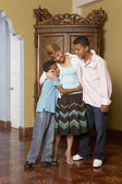 Hispanic mother and sons hugging — Stock Photo