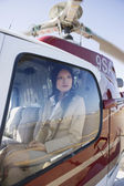 Asian businesswoman in helicopter — Stock Photo