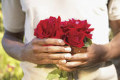 Midsection of man holding roses — Stock Photo