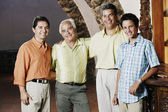Male members of a family smiling for the camera — Stock Photo
