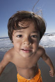 Portrait of boy looking into camera at beach — Stock Photo