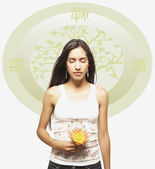 Young woman meditating with flower against Oriental background — Stock Photo