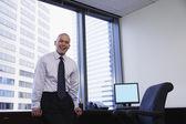 Smiling businessman looking at camera — Stock Photo