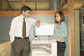 Businesspeople standing at copy machine — Stock Photo
