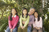 Asian grandmother with granddaughters outdoors — Stock Photo