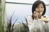 Portrait of Asian woman eating dessert — Stock Photo