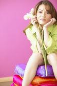 Portrait of woman holding flower — Stock Photo