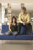 Couple on sofa at hair salon — Stock Photo