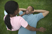 Young couple relaxing on grass — Stock Photo