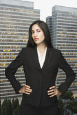 Businesswoman posing in front of city landscape — Stock Photo