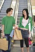 Multi-ethnic teenage couple in mall — Stock Photo