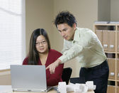Businesspeople with laptop in office — Stock Photo