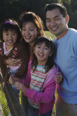 Asian family smiling in the countryside — Stock Photo