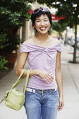 Woman standing outdoors — Stock Photo