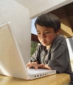 Boy working on computer — Stock Photo