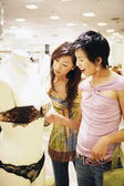 Two women shopping for lingerie — Stockfoto