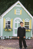 Boy in front of toy house — Stock Photo