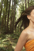 Woman's hair blowing in forest — Stock Photo