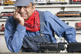 Man dressed as conductor in hobby shop — Stock Photo