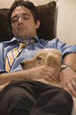 Dad after Work Asleep with Dog — Stock Photo