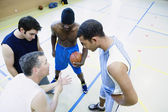 High angle view of coach talking to basketball team — Stock Photo