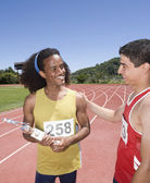 African male runner being congratulated on track — Stock Photo