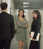 Businesswomen admiring colleague in office space — Stock Photo