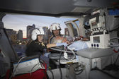 Doctors with patient in medical helicopter — Stock Photo